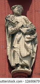 WURZBURG, GERMANY - JULY O4, 2018: Saint Peter the Apostle statue on the portal of the Marienkapelle in Wurzburg, Bavaria, Germany
