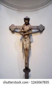 WURZBURG, GERMANY - JULY O4, 2018: Schmerzensmannkreuz, Jesus on the cross, his arms crossed like a gesture of embrace, Neumunster Collegiate Church in Wurzburg, Germany