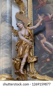 WURZBURG, GERMANY - JULY O4, 2018: Angel statue on the St. Michael altar in the Neumunster Collegiate Church in Wurzburg, Germany