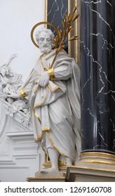 WURZBURG, GERMANY - JULY O4, 2018: Saint Joseph statue on the The Dean's Altar in Wurzburg Cathedral dedicated to Saint Kilian, Bavaria, Germany