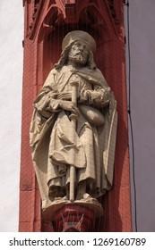 WURZBURG, GERMANY - JULY O4, 2018: Saint James the Apostle statue on the portal of the Marienkapelle in Wurzburg, Bavaria, Germany