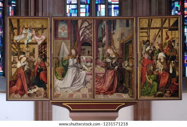 WURZBURG, GERMANY - JULY O4, 2018: The Annunciation and Nativity Scene, main altar in Marienkapelle in Wurzburg, Bavaria, Germany