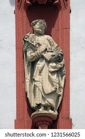WURZBURG, GERMANY - JULY, O4,2018: Saint Peter the Apostle statue on the portal of the Marienkapelle in Wurzburg, Bavaria, Germany