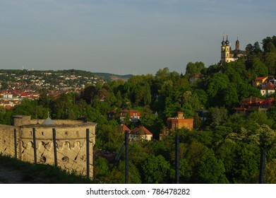 WURZBURG, GERMANY - MAY 11, 2015: A view of the Marienberg Fortress or Festung in Autumn with walking woman in front