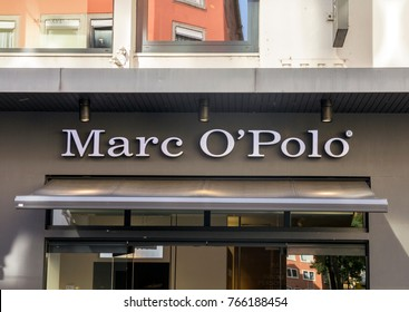 Wurzburg, GERMANY SEP 2, 2017: Marc O'Polo fashion company brand trademark logo in the front of store. Marc O'Polo is a Swedish-German fashion label