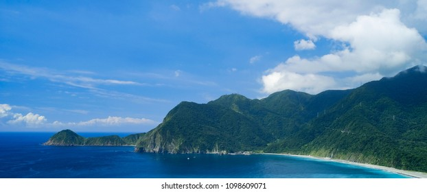 Wushihbi Coast Landscape - Famous natural spot of Yilan, Taiwan. Birds eye aerial view with morning blue bright sky and sunlight.