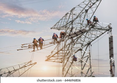 Wuxi, China - May 5, 2017: Several electric workers installed cables on tall towers, wuxi city in jiangsu province,in China