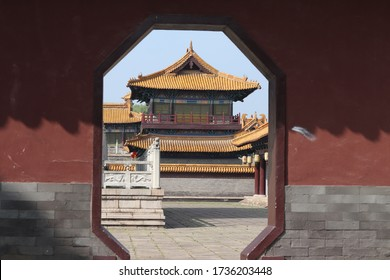 Wuxi/China-May 2020: an imperial palace located in a famous attraction spot of Wuxi, named Shuihu Town, many costume drama filmed here. Beautiful golden tile and red wall.