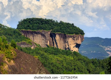 Wuyishan, Fujian Province China. Wuyi Mountain Scenery, Chinese National Park. China Danxia Exotic Cliff Scenery. UNESCO World Heritage, Daoism and Lingnan Culture. Forest Growing on Side of Cliffs