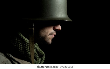 WW2 American Soldier With Face In Deep Shadow