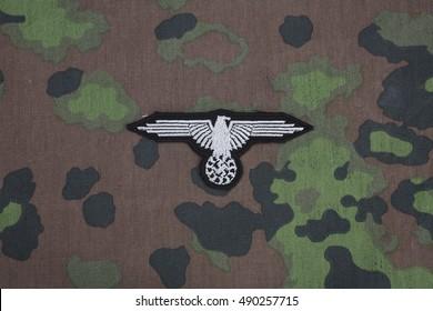 WW2 German Waffen-SS military insignia on SS camouflage uniform