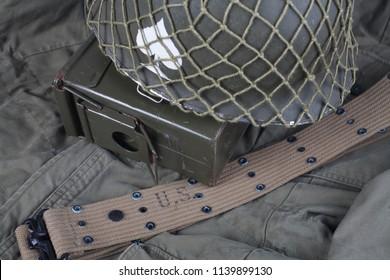 ww2 us army helmet with ace of spades emblem on green uniform