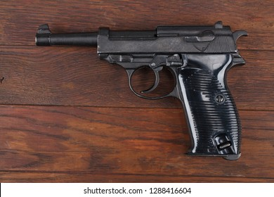 WWII era german army handgun on wooden table
