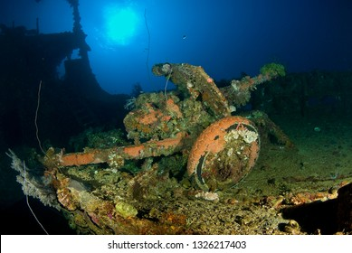 WWII Japanese artillery gun on the deck of a Japanese freighter in Truk Lagoon