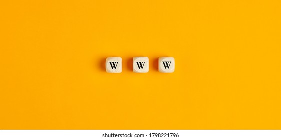 WWW inscription on wooden blocks against yellow background. Flat lay view.
