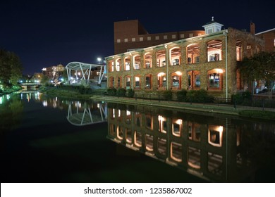 Wyche pavilion reflecting in the waters of the Reedy River in downtown Greenville, South Carolina