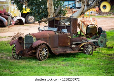 WYCHEPROOF, VICTORIA, AUSTRALIA - 06 JUNE 2017: The rusted shell of an old vintage car decays peacefully on a rural property just outside of Wycheproof in the Mallee country of North West Victoria.