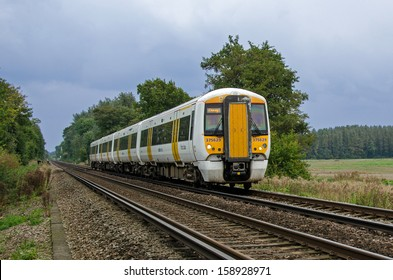 WYE, KENT - 11 OCT:  A Southeastern Class 375 Electric Multiple Unit near Wye, Kent, England on 11 October 2013.  The train is travelling from Ramsgate to London Victoria.