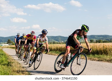 WYHL, GERMANY - JULY 11: Amateur competitors of the road cycling criterium race against each other in Wyhl, Germany on 07/11/15. It is an amateur race category C and B corresponding to BDR categories.
