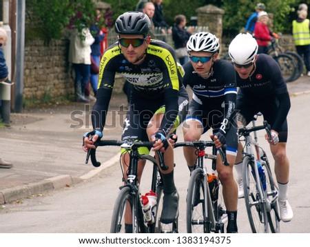 WYMONDHAM, LEICESTERSHIRE, UK - APRIL 28 2019: Rutland-Melton Cicle Classic- Wim Kleiman of Dutch UCI Continental Team Monkey Town leads Josh Housley of Team PB Performance and Matt Nowell of St Piran