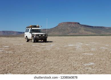Wyndham, Western Australia - July 16, 2010: A 4WD vehicle on the mud flats near Wyndham in the Kimberley region of the Western Australian outback.
