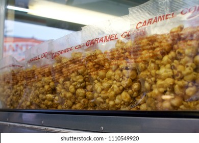 WYndmoor, PA, USA - June 8, 2018: Bags of caramel corn are among the sugary treats found at a local carnival's concession stand.