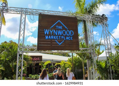Wynwood, FL/USA- January 25, 2020- people shopping on a sunny winter day at The Wynwood Marketplace.