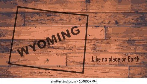 Wyoming state map brand on wooden boards with map outline and state motto