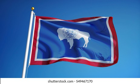 Wyoming (U.S. state) flag waving against clear blue sky, close up, isolated with clipping path mask alpha channel transparency, perfect for film, news, composition
