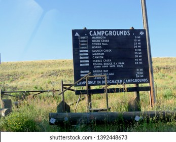 Wyoming, USA--July 2018: Roadside sign near the north entrance with status information and distances for campgrounds at Yellowstone National Park.