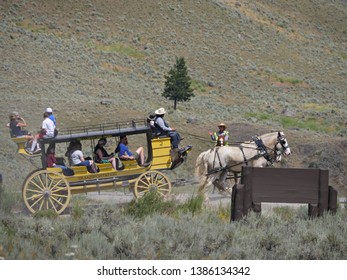 Wyoming, USA--July 2018: Visitors ride the stagecoach at Cooke Pass. The stagecoach ride is one of the popular attractions at Yellowstone National Park.