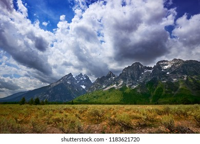 Wyoming's towering Grand Tetons against a stormy sky