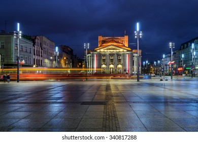 Wyspianski Theatre on the central square of the Katowice, and the tram in the evening. Poland