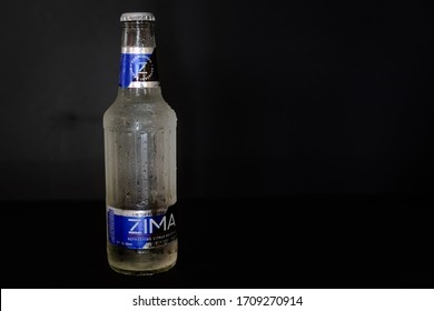 Wytheville, VA USA April 20, 2020 An ice cold Zima citrus alcoholic drink on a black background. Zima was popular in the 90's and brought back for a limited time in 2019.