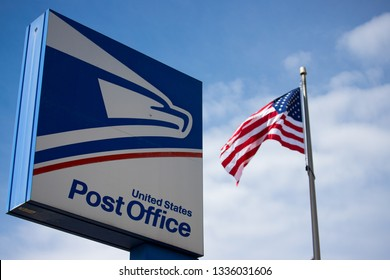 Wytheville, VA/USA-March 11, 2019 United State Postal Service sign with American Flag and Blue Sky