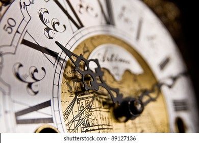 The X hour An old-style pendulum clock face with focus on the hour hand pointing to X or 10