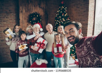 X mas fairy. Self-portrait of cheerful full family with large gift boxes. Noel gathering. Grey-haired grandparents, grandchildren, sister, brother, son, daughter at house party, meeting, fir tree