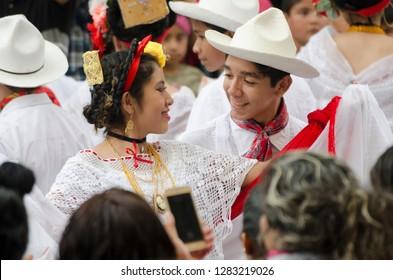 XALAPA, VERACRUZ, MEXICO- NOVEMBER 18, 2018: Portrait of a young couple dressed with traditional clothes from Veracruz at Record La Bamba 2018 in Xalapa, Veracruz, Mexico