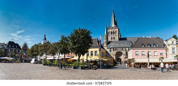XANTEN, GERMANY - SEPTEMBER 07, 2016: Unidentified individuals enjoy the scenic marketplace with St. Victor's Cathedral - High Resolution - Hyperrealism