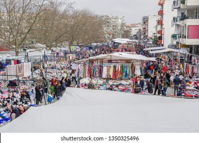 Xanthi Greece - March 09 2019: Street vendors selling products at large bazaar market. Open air street vendors selling clothes & other merchandise at stalls every Saturday at weekly bazaar flea market