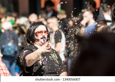 XANTHI, GREECE - MARCH 10, 2019: Masquerade participants march and have fun in colorful costumes. Small and big groups of Greek people parade annually on city streets in thematic festival outfits