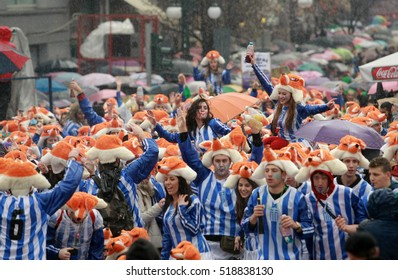 XANTHI, GREECE - marth 2, 2014: Unidentified friends dressed in colorful costumes during the annual Carnival Parade in Xanthi, Greece. Group of people dancing dressed in carnival costumes.