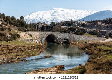Xanthos river and historic Ottoman bridge at Urluca village near Fethiye town in Turkey.
