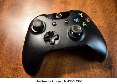 Xbox One Controller Displayed On Wood Table, Editorial