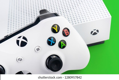 Xbox One S Console and Controller on a green background