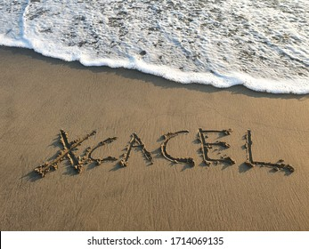 xcacel text handwritten in beach sand, background and texture