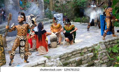 XCARET, MEXICO - DECEMBER 28, 2018: Pre-Hispanic Mayan amerindian people performance into the jungle in the ancient Mayan Village, Riviera Maya, Mexico