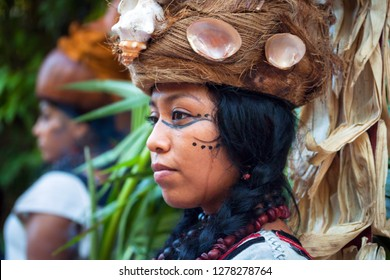 """Xcaret, Mexico - July 19, 2011: Woman at pre-hispanic Mayan performance called """"Dance of the Owl"""" in the jungle at ancient Mayan Village"""