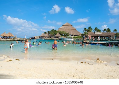 XCARET,MEXICO - APRIL 16,2019 : Families at the beach at XCaret Park on the Mayan Riviera on a beautiful sunny day