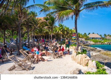 XCARET,MEXICO - APRIL 16,2019 : People relaxing at the beach on the XCaret park on a beautiful sunny day